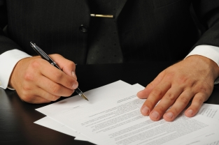 The businessman the signing contract. Hand closeup.