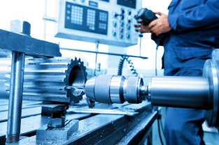 40493981 - man operating cnc drilling and boring machine in workshop. industry, industrial concept.